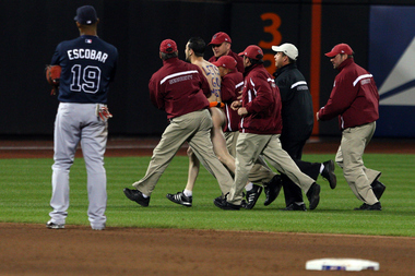 Mets security escort a streaker  from Citi Field in 2009. Internal documents show Citi Field cut its security staff between 2009 and 2013, raising concern that it would lead to longer response times to emergencies and fights.