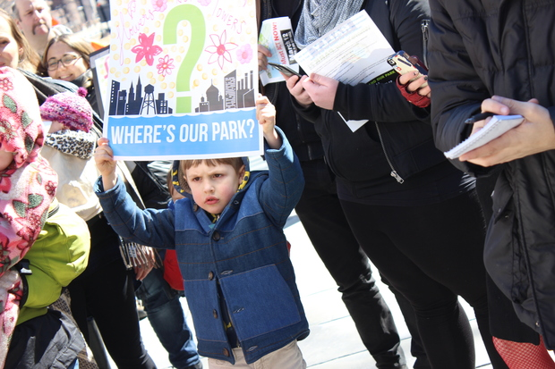 Hundreds of Greenpoint and Williamsburg residents flooded City Hall steps on Thursday afternoon to demand that the city fulfill its promise to build 28-acres of park space on the Williamsburg waterfront.
