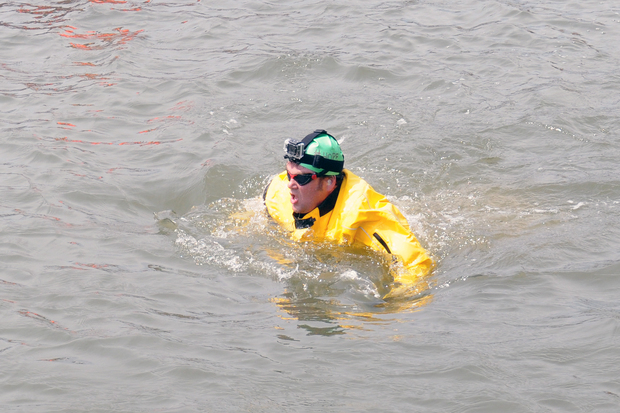Christopher Swain tried to swim the entire length of the Gowanus Canal on Earth Day to advocate for making the water clean enough to swim in, April 22, 2015.