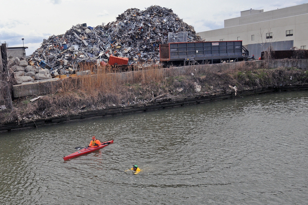 Environmental activist swimming in the Gowanus Canal. State health officials said in a new report that swimming in the canal could harm people's health.
