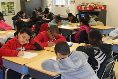 Students at the Bronx Academy of Promise work on preparing for their upcoming state tests in math and English.