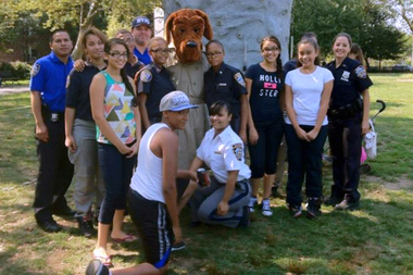 McGruff the Crime Dog poses with kids at an NYPD-sponsored event.
