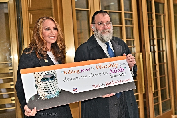 Pamela Geller, executive director of the American Freedom Defense Initiative, holds the advertisement that prompted the MTA to ban all political ads.