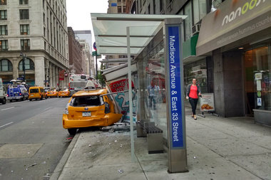 A cab crashed through a Midtown bus stop Tuesday morning.