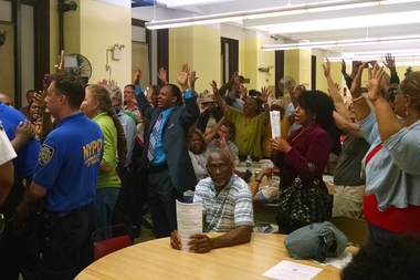 Attendees of Tuesday night's Brooklyn Community Board 9 meeting shouted