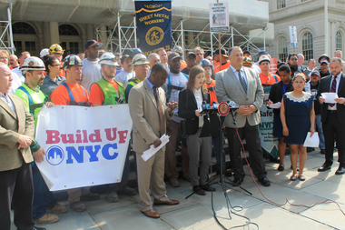 Charlene Obernauer, the executive director of New York Committee for Occupational Safety and Health (NYCOSH), talking about unsafe work conditions for construction workers on City Hall steps on May 11, 2015. She was joined by construction workers, their unions, work safety advocates and Monica Velazquez (far right) the daughter of a construction worker who recently died on the job.