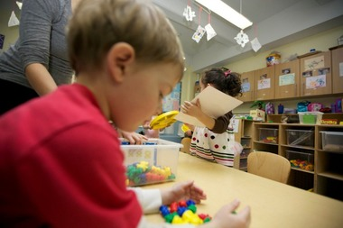 A student in Nagle Avenue Y's early childhood program works with manipulatives.