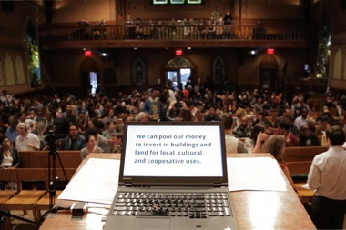 An image from the first meeting for the NYC Real Estate Investment Cooperative, held in April and attracting more than 350 people.