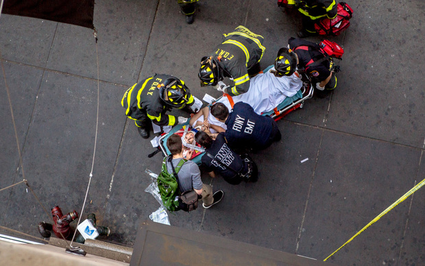 A woman was taken to Bellevue Hospital after she was struck by falling debris near Prince Street and Broadway on May 8, 2015.