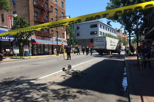 The cyclist was run over by a box truck in Prospect Park South, police said.