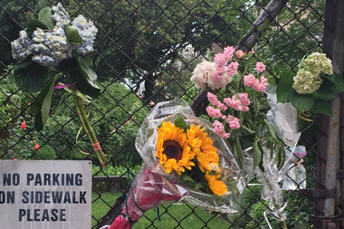 Flowers left on the gate in front of the Degraw Street garden that Christopher Adlington tended to.