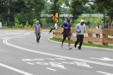 Runners exercised on the East Drive in Prospect Park Thursday following the mayor's announcement that cars would be banned in most of the park, except for two hours during the morning rush on the east side road.