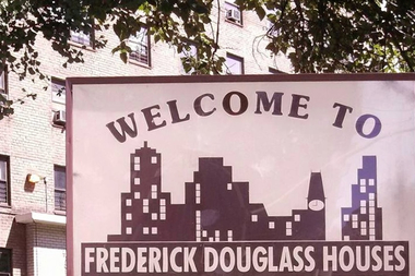 A sign for the Frederick Douglass Houses.
