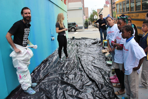 NOVE, an artist from Brazil, spent Monday morning painting with students from the Mott Haven Academy Charter School.