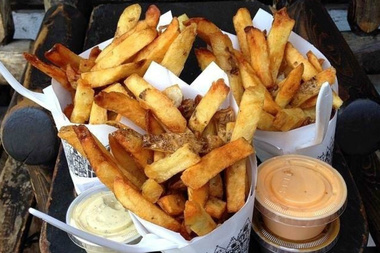 Pommes Frites' Belgian fries and assortment of dipping sauces are moving to Greenwich Village, where the owners hope to reopen later this year.