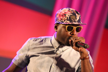 Rapper Talib Kweli performs onstage during the Acoustically Speaking event during the 2014 BET Experience At L.A. LIVE on June 28, 2014 in Los Angeles.