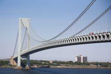 The opening of the new HOV/bus lane on the Verrazano-Narrows Bridge snarled traffic during the morning commute after construction hit delays.