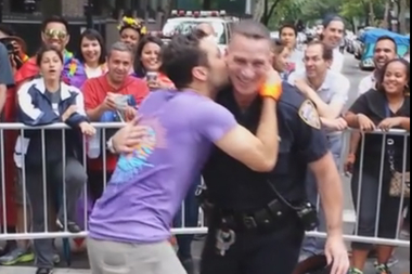 An NYPD officer took a moment to celebrate at Sunday's Pride Parade in New York City.