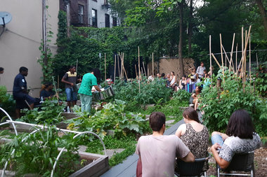 Apocalypse Chow, a free July series, offers solar-cooked meals and artist performances at the Bedford-Stuyvesant Community Garden.