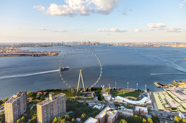 The New York Wheel is suing its designer and builder over threatening to pull out of the agreement to build the wheel.