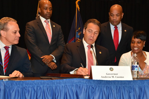 Surrounded by the family members of people who have been killed by police, Gov. Andrew Cuomo signed an executive order Wednesday appointing Attorney General Eric Schneiderman as a special prosecutor to examine such cases.
