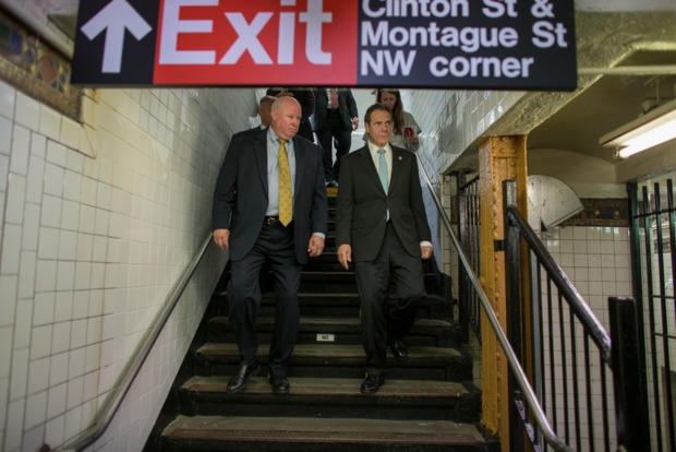 Gov. Andrew Cuomo and MTA Chairman Thomas Prendergast tour the Montague Tunnel prior to arriving at the newly reopened Whitehall Street Subway Station on September 14, 2014.