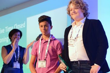 Daniil Frants, right, won an award for an invention that helps deaf people follow conversations. His classmate Ilan Pesselev, left, helped with some of the later stages of the project.