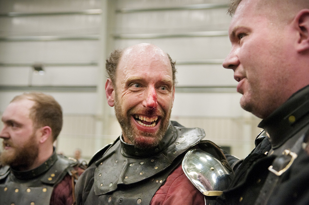 Dave Olsen jokes with Dustin Goodale at the end of the Armored Combat League National Qualifiers in Pitman, NJ. The photo is part of his ongoing series, Modern Knights.