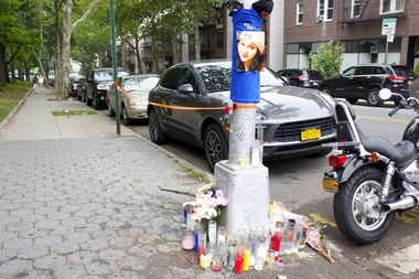 A memorial at the corner of Ditmars Boulevard and 19th Street, where Betty Jean DiBiaso was struck and killed by a hit-and-run driver in 2015.