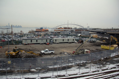 An Ironworker at the Empire Outlets project sued the contractor and a co-worker for discrimination after the co-worker snapped pictures of her in the bathroom, a lawsuit claims.
