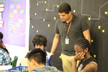 Columbia University student Gabriel Lopez, who receives help from Breakthrough New York, tutors students at the Town School program.
