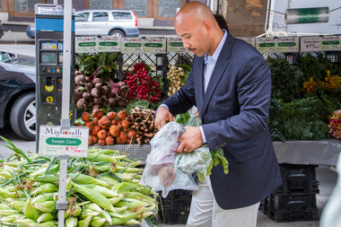 Bronx Borough President Ruben Diaz Jr. picks out some vegetables at the new Hostos Greenmarket.