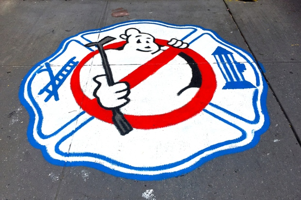 A new Ghostbusters emblem is now painted on N. Moore Street.