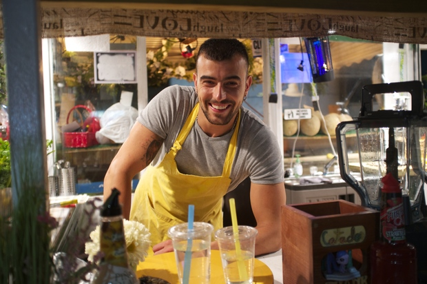 Tolgahan Cetinkaya smiles behind the juice bar at Juice N' Beatz on Northern Boulevard, which opened in the beginning of summer 2015.