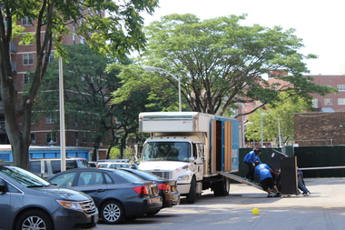 Men move filing cabinets into a truck outside Lindsay Park's office.