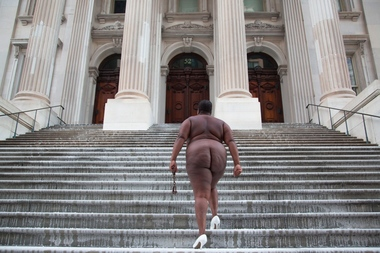 Artist Nona Faustine poses at 52 Chambers Street, Tweed Courthouse. The photo is titled