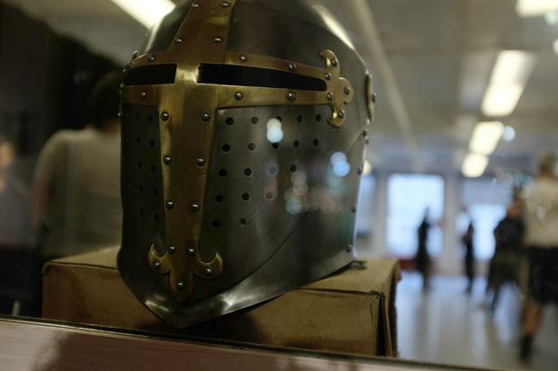 A sword-fighting school offers armored combat classes.