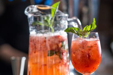The drink is made with muddled strawberries and basil mixed with agave nectar and fresh lemon juice.