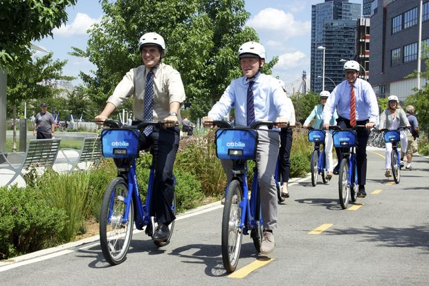 Officials cut the ribbon on the first bike share station in the borough on Wednesday.