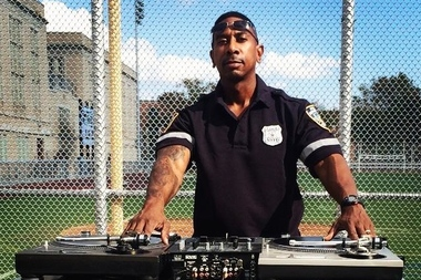 The 78th Precinct's Lt. Acu Rhodes, also known as DJ Ace. Though he would ordinarily wear a white shirt as a lieutenant, Rhodes wore a blue police officer shirt at a 2014 Cops vs. Kids DJ battle.