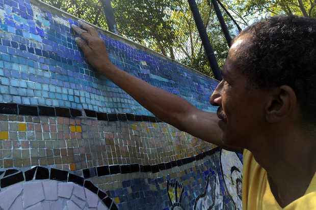 "CITYarts, the organization that created the ""Peace Wall"" at 138th Street and Amsterdam Avenue, is restoring the mural they helped create in 2005."