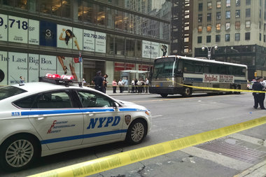 A woman was jaywalking when a bus hit her on West 57th Street, officials said.