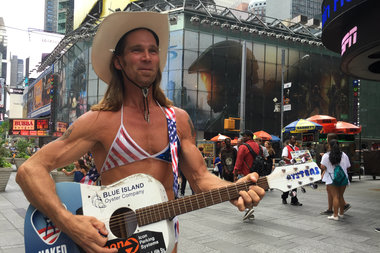 Naked Cowboy Robert Burck wore a bra on Wednesday weighing in on the push to regulate topless performers in Times Square.