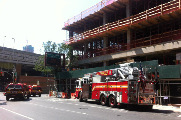 The man was hurt in a fall at 577 Ninth Ave., officials said.