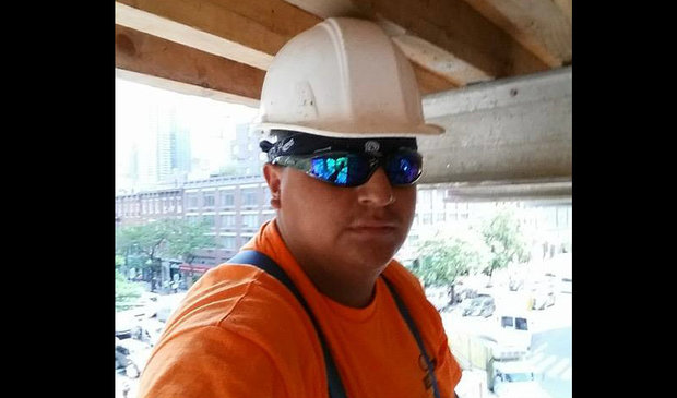 Angel Muñoz, 27, from Ecuador, died when he fell down an elevator shaft on Tuesday, police said.