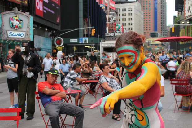 An artist will be painting nudes in Times Square for the next few days showing his support for topless women.