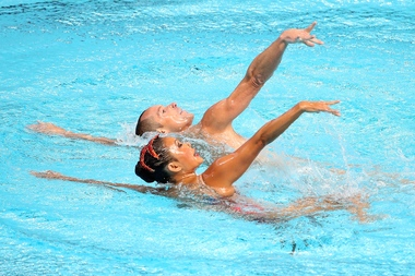 Americans Kristina Lum Underwood and Bill May compete at the 16th FINA World Championships in Kazan, Russia in July 2015. A new synchronized swimming club in Brooklyn is welcoming both men and women.