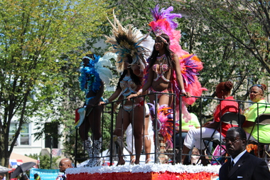 The West Indian American Day Carnival Association will move their headquarters to the Bedford-Union Armory, the building's developers said. Here, costumed women dance on the official WIADCA float at the 2015 parade on Eastern Parkway.