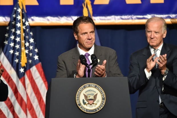With Vice President Joseph Biden at his side, Gov. Andrew Cuomo said he was going to propose that the legislature increase the statewide minimum wage to $15 per hour during a speech on Thursday, Sept. 10, 2015 at the Jacob Javits Center.