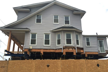 A home being lifted through the city's Build It Back program, which was slammed last week at a City Council hearing.